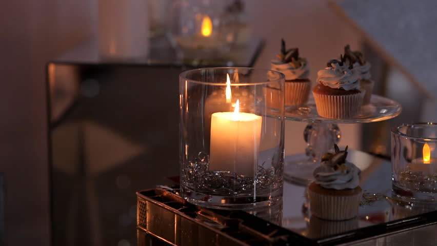 Burning a candle in a festive atmosphere | Shutterstock HD Video #1007631313
