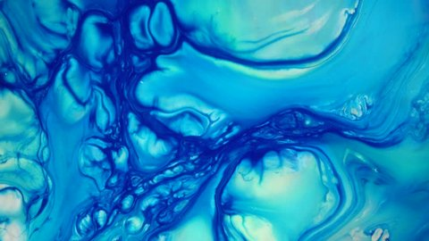 4K footage. Ink in water. Blue ink reacting in water creating abstract background.