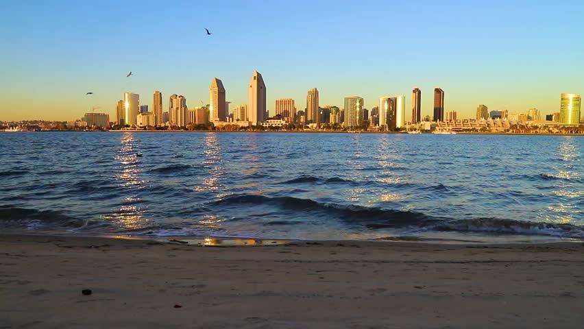 The sunset over the San Diego skyline across San Diego Bay from Coronado Island.