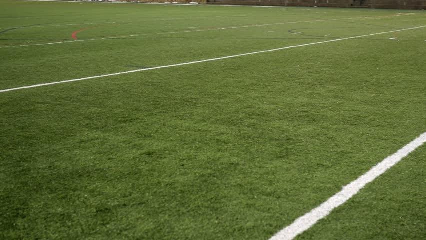 Football Field 10 yard line pan over turf grass #1007657533