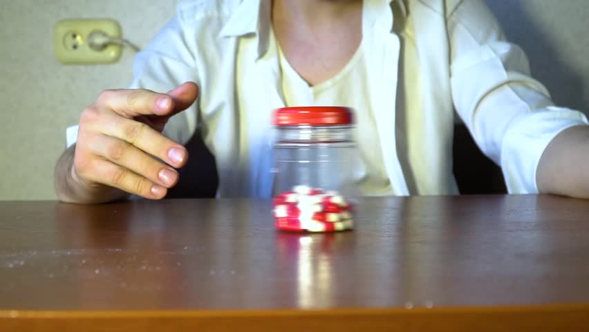 A jar with tablets is rolled on the table | Shutterstock HD Video #1007668171