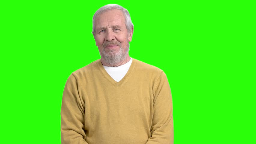 Cheerful mature man showing thumb up. Elderly man in sweater giving thumb up and looking at camera, chroma key background.