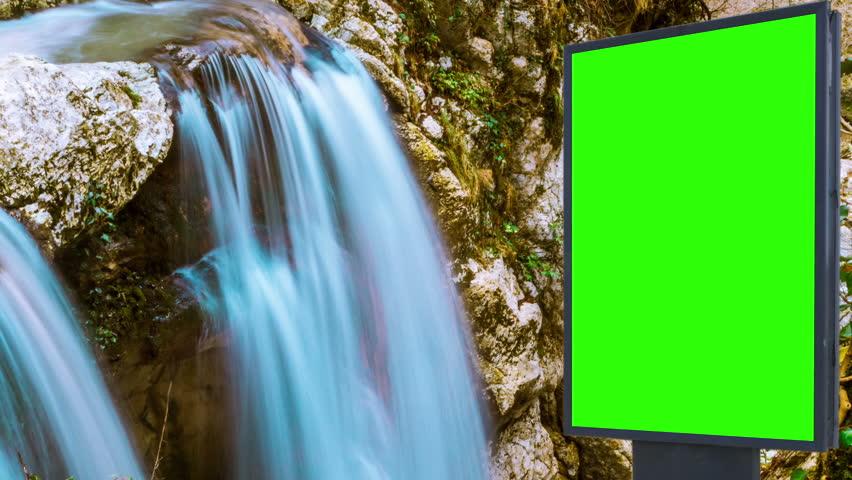 Billboard green screen near the Fabulous waterfall   Shutterstock HD Video #1007703976