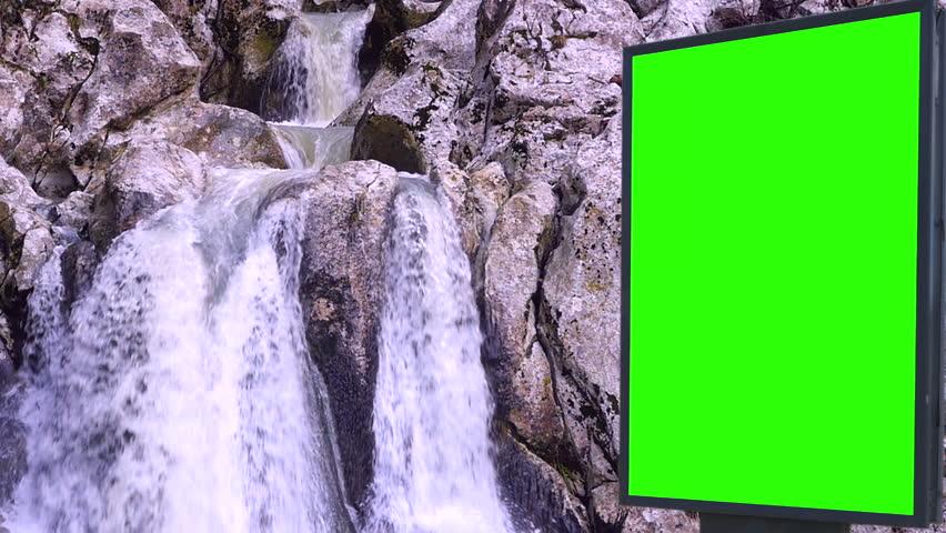 Billboard green screen near the Fabulous waterfall   Shutterstock HD Video #1007704009