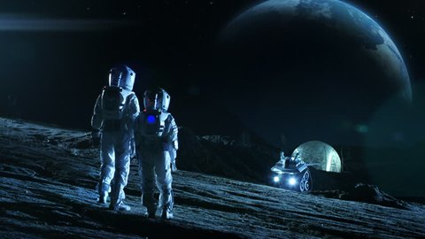 Two Astronauts in Space Suits Stand on the Moon Looking at the Beautiful Earth. In the Background Lunar Base with Geodesic Dome. Moon Colonization and Space Travel Concept. Establishing Shot.