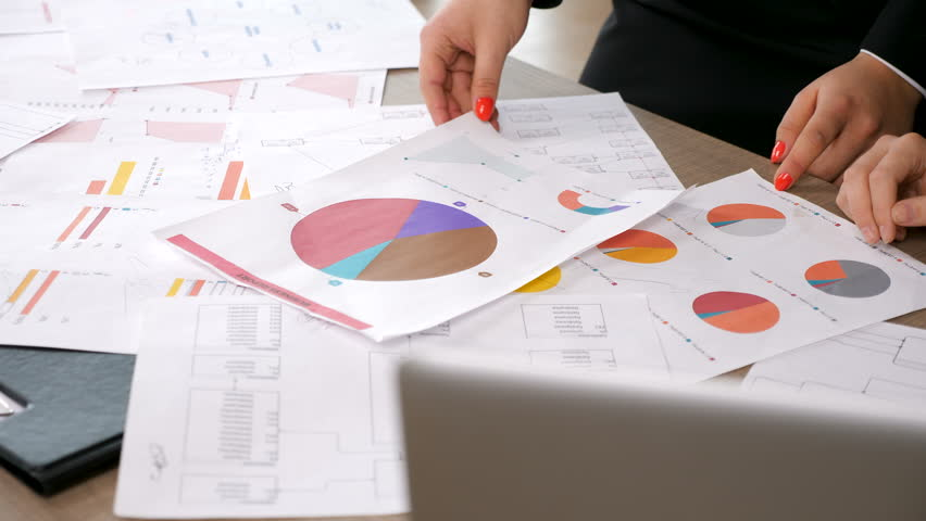 Close up on hands of businesswomen looking at a business report | Shutterstock HD Video #1007760973