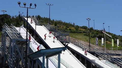 Park City, Utah, USA, June 2015. Free, public aerial exhibition of all skiers jumping into pool during summer at the Utah Olympic Park, former location for the 2002 Olympic Winter Games.