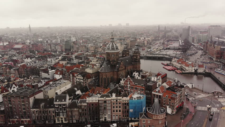 AMSTERDAM, NETHERLANDS February 18, 2018: The Sint-Nicolaaskerk at the cetral station in Amsterdam, Netherlands, in an aerial shot.
