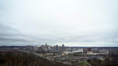 4K Footage of Cincinnati Skyline on an overcast day with high waters on the Ohio River.
