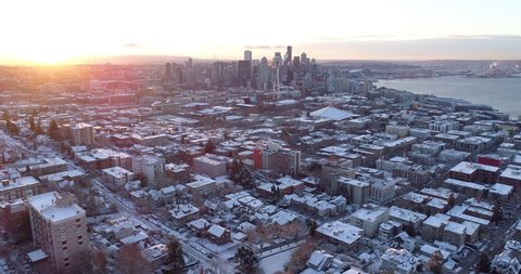 Seattle Washington Aerial View Winter Snow Sunrise Rays of Light Flying Above City Downtown