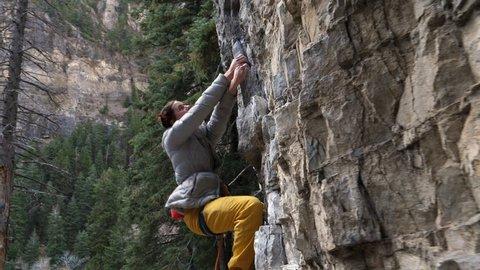 Tracking shot of woman rock climbing / American Fork Canyon, Utah, United States