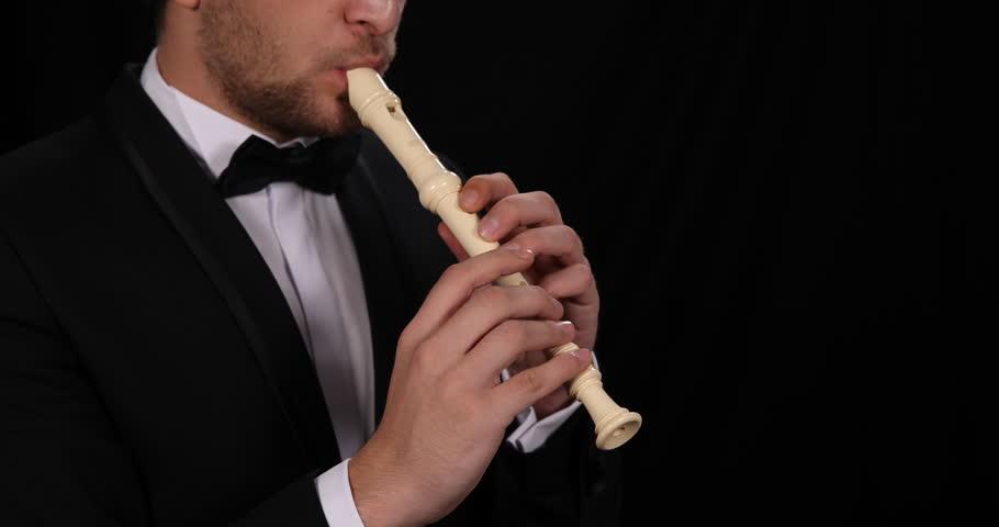 Close Up Shot of Soloist Flutist Man Play Recorder Flute Classic Music Concept