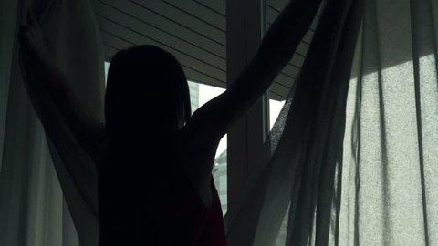 Woman unveil curtains, open door to terrace, super slow motion, 240fps