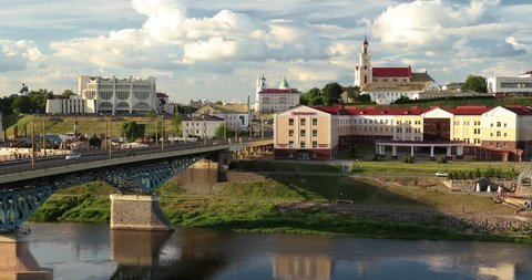 Grodno, Belarus. Bridge Across Neman River, Grodno Regional Drama Theatre, St. Francis Xavier Cathedral And Bernardine Monastery At Summer Sunny Day. Zoom, Zoom Out.