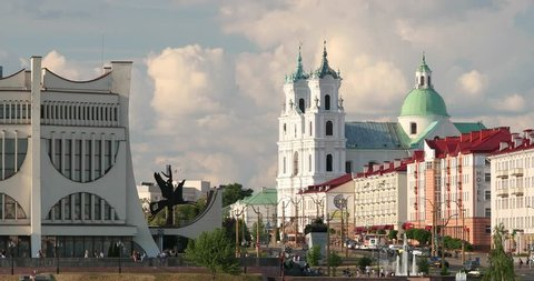 Grodno, Belarus. Grodno Regional Drama Theatre, St. Francis Xavier Cathedral And Traffic In Mostowaja And Kirova Streets In Sunny Summer Day