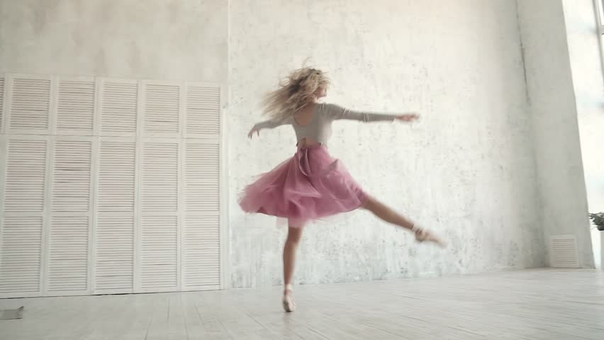 Ballet dancer is spinning and jumping high in a tutu and pointe shoes. young ballerina is dancing. slow motion | Shutterstock HD Video #1008106693