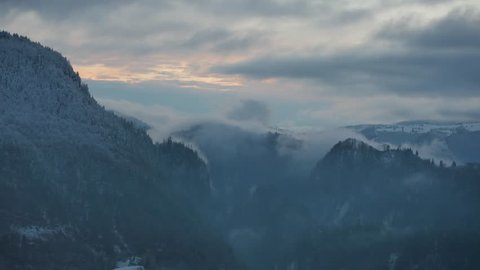 Timelapse in the Carpathian Mountains in the region of Transylvania in Romania during the winter season.