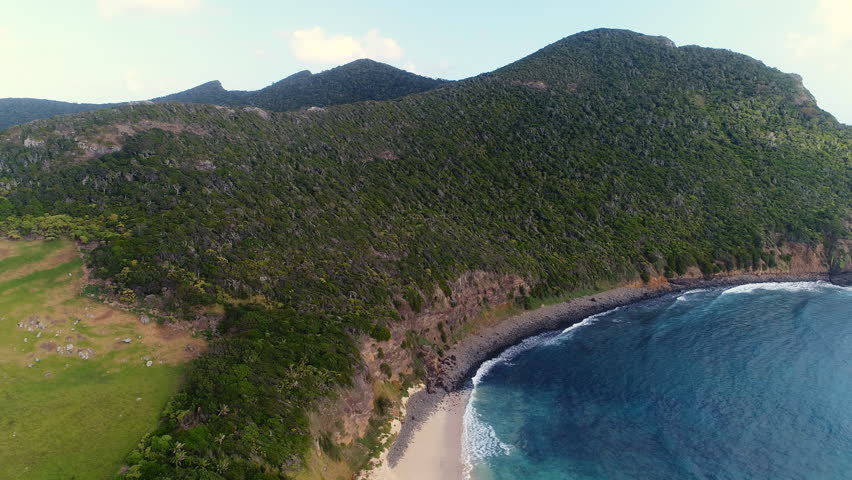 Aerial view of Ned's Beach location on Lord Howe Island (World Heritage-listed paradise) - New South Wales - Tasman Sea - Australia from above, 4k UHD #1008122713