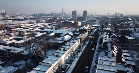 Sweeping drone footage of residential buildings in South West London, England, after