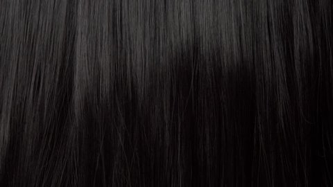 Hair texture background, no person. Black shiny hair moving slowly 24 fps from 60 fps