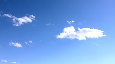 White Clouds & Blue Sky, Flight over clouds, loop-able, cloudscape, day, Time lapse clip of white fluffy clouds over blue sky, Towering Cumulus Cloud Billows, 3840x2160, 30FPS, UHD.
