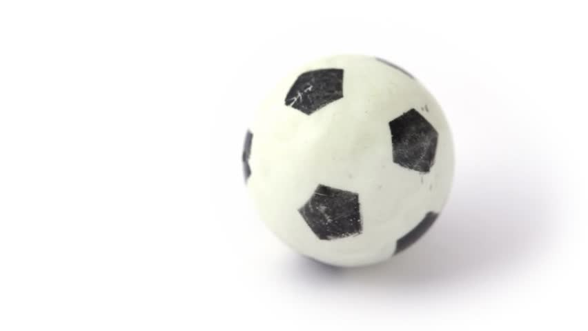 Small toy soccer ball rotating on white | Shutterstock HD Video #1008223