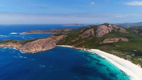 Aerial view of picturesque coastline scenery of Hellfire Bay, colorful cliffs and rocks, white sand beach and crystal clear water - Cape Le Grand, Esperance, Western Australia from above, 4k UHD
