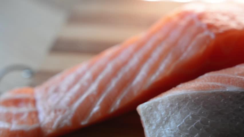 Fresh Salmon Fish on the wooden  kitchen | Shutterstock HD Video #1008261463