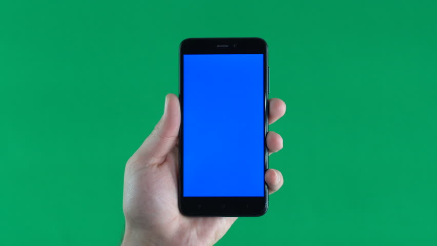 Phone with blue screen on hand, isolated on green background, vertically