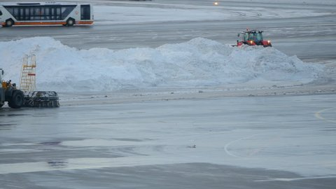 Snowblower clearing snow in airport