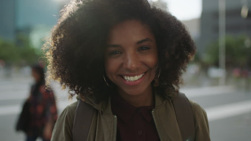 Portrait of beautiful trendy african american woman smiling at camera looking confident running hand through hair enjoying urban city lifestyle real people series | Shutterstock HD Video #1008365473