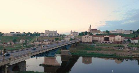 Grodno, Belarus. Bridge Across Neman River, Grodno Regional Drama Theatre, St. Francis Xavier Cathedral And Bernardine Monastery In Evening Time. Zoom, Zoom In.