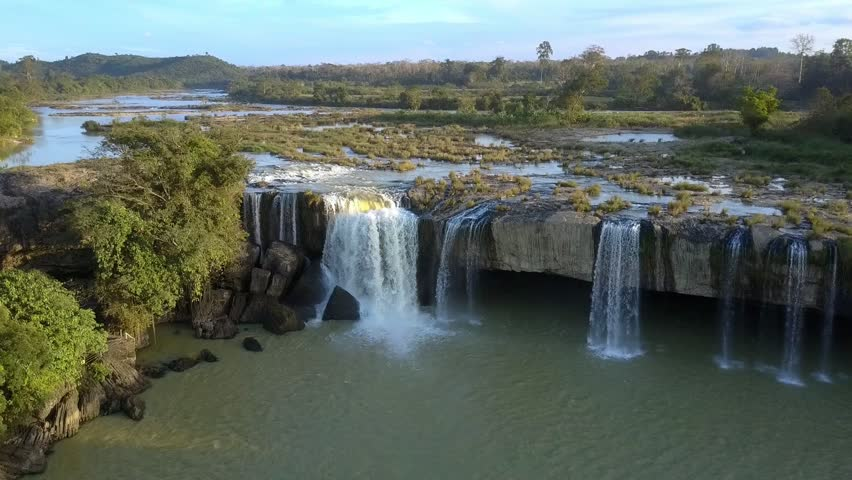 pictorial upper view sunset beams light waterfall stone cascade and fresh green tropical trees