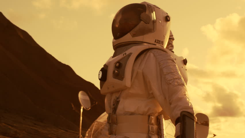 Following Shot of the Astronaut On Mars Walking Toward His Base/ Research Station, Looking Around. First Manned Mission To Mars, Technological Advance Brings Space Exploration, Colonization. | Shutterstock HD Video #1008373453