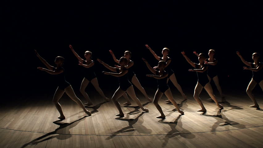 A choreographed dance of a group of graceful pretty young ballerinas practicing on stage in a classical ballet school. Children are taught ballet positions in choreography. Ballet. Scene. | Shutterstock HD Video #1008452203
