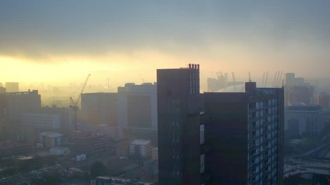 Drone shot of London O2 arena at sunrise on a foggy morning