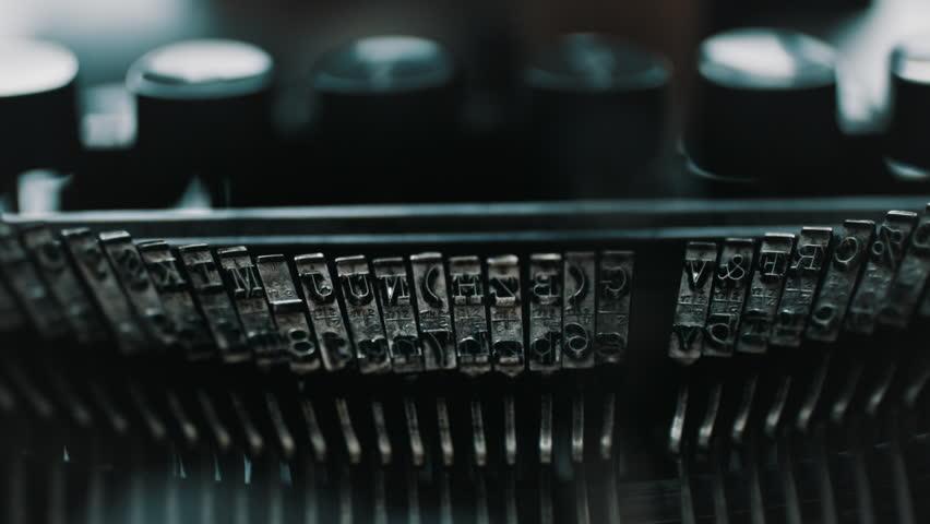 Slow motion closeup shot of detail of vintage typewriter metallic letters   Shutterstock HD Video #1008548623