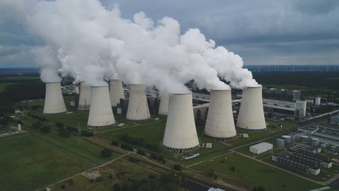 JANSCHWALDE, GERMANY - SEPTEMBER 2017: Static drone shot of huge lignite (brown coal) fired power station in Eastern Germany, heavy air pollution in Europe