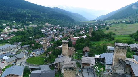 Aerial footage in Mestia v08, Georgia. Ancient historical Svaneti towers among dwelling houses