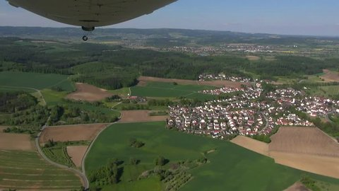 Flight over landscape in southern Germany, view to vineyards,apple orchards,agriculture, Lake Constance (Bodensee) near Muehldorf Uhldingen with a zeppelin, may 2013, spring time,