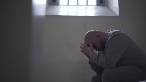 Prisoner Alone In Dark Cell, Cinematic Silhouette. Incarceration In Modern Prison, 4K Inmate Locked Up.