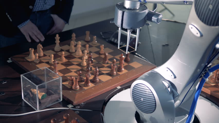 Moving a pawn by a robotized arm.