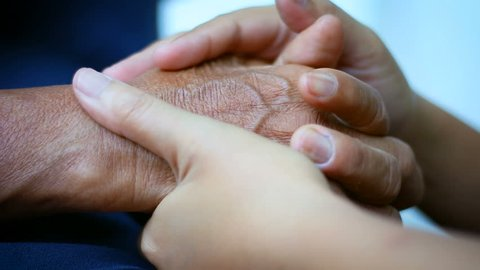 Hands of young woman holding and gentle touch to Hands of old women metaphor and concept for body language feeling love soothe and hope of family old mother and young daughter