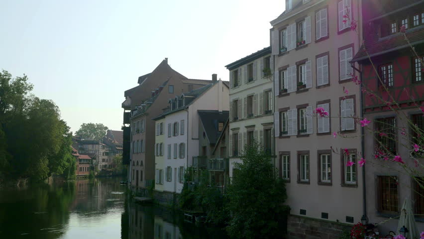 Amazing traditional timbered houses located on idyllic river Ill in the Petite France quarter of Strasbourg. Morning video shot with panning camera motion.