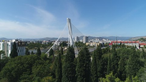 PODGORICA, MONTENEGRO - SEPTEMBER 2017: Panoramic drone shot of futuristic Millennium cable-stayed bridge and skyline of Podgorica, infrastructure in Montenegro, Southeastern Europe