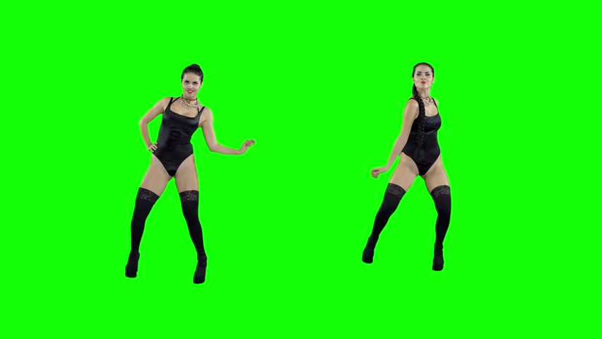 Girl in a girl in a black swimsuit with a ball in the shape of a heart, on a green screen #1008757163