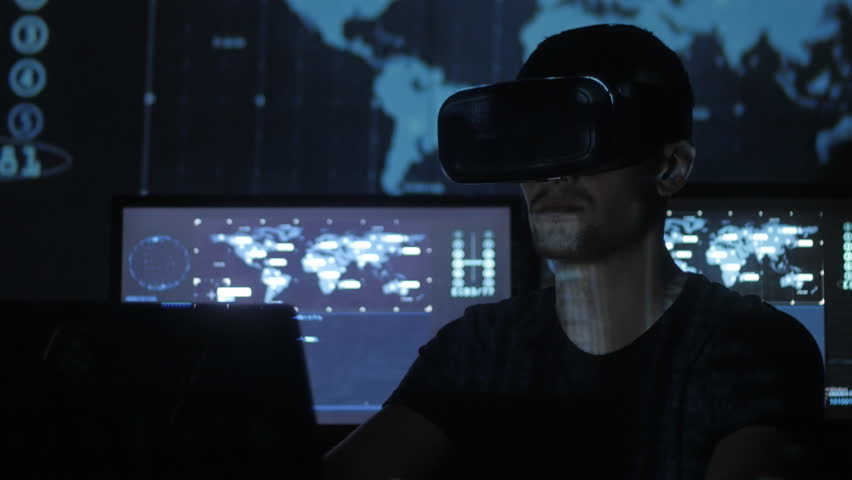 Man hacker programmer uses a virtual reality helmet for programming. IT Technologies of the Future.   Shutterstock HD Video #1008776873