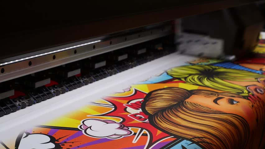 Industrial printing on woven material, modern digital inkjet printer puts a picture on a cloth canvas