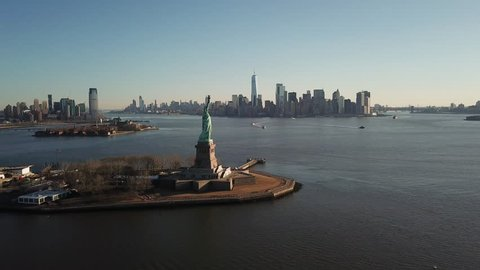 Statue Of Liberty Aerial Moving Forward over Water Toward Manhattan New York City Skyline 4K and 1080 HD NYC