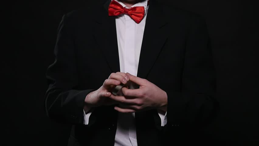 Magic, card tricks, gambling, casino, poker concept - man showing trick with playing cards | Shutterstock HD Video #1008822323